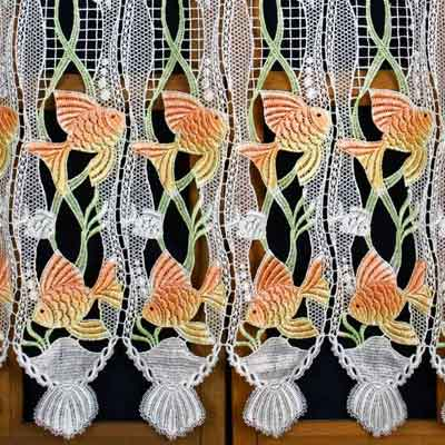 Colored fish lace curtain