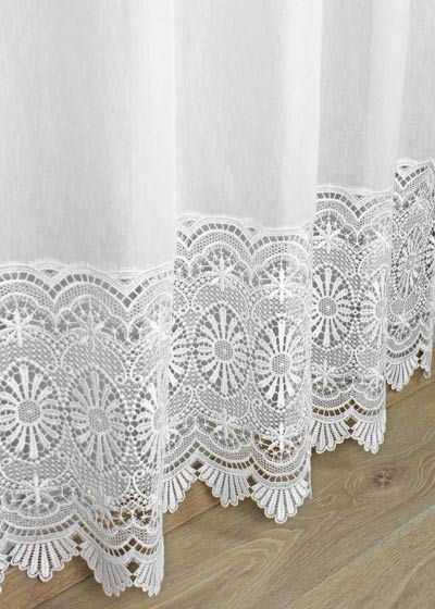 Sheer curtain with macrame
